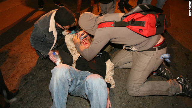 Occupy Oakland protesters tend to Scott Olsen -- who was injured in a Tuesday night protest.